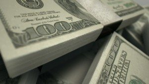 1397162190_stock-footage-an-extreme-closeup-pan-across-variously-placed-bundled-wads-of-us-dollar-banknotes